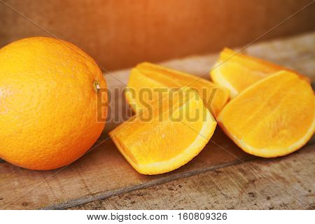 Fresh orange on wooden background for healthy. Organic or clean fruit from orchard in the market. Clean fruit and drink for healthy and diet. Low sugar fruit for diet and feeling fresh when drinking.