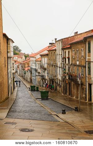 SANTIAGO SPAIN - AUGUST 17: View of Santiago street under the drizzle on August 17 2016