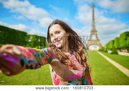 Woman Tourist At Eiffel Tower Smiling And Making Travel Selfie