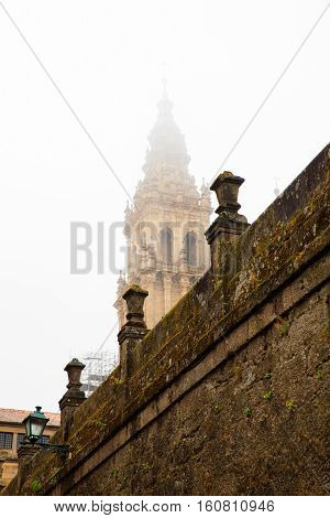 View of the belltower of the Santiago cathedral covered by fog Spain