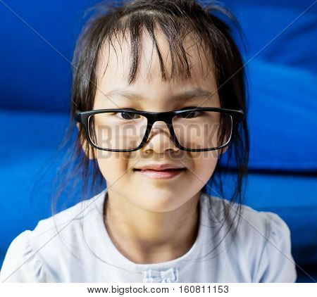 smile Asian girl look nerdy wearing glasses