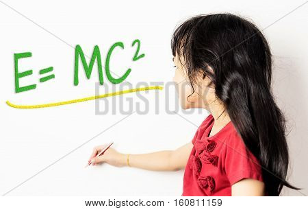 Little Chinese girl is learning science formular