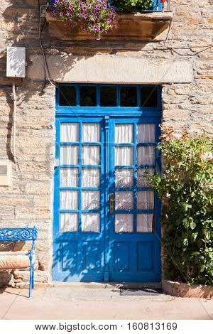View of pretty blue door of spanish house