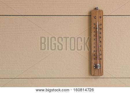 thermometer on wood background, celsius and fahrenhit