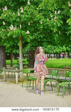 Beautiful Young Woman In The Tuileries Garden In Paris