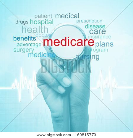hand holding stethoscope with medicare word. medical concept