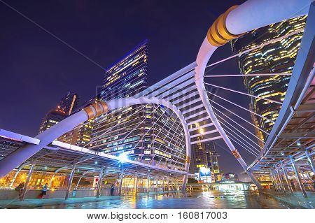 Cityscape of Sathorn at night in Bangkok, Thailand.