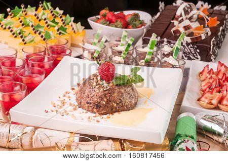An array of Christmas desserts with bon bon on a table