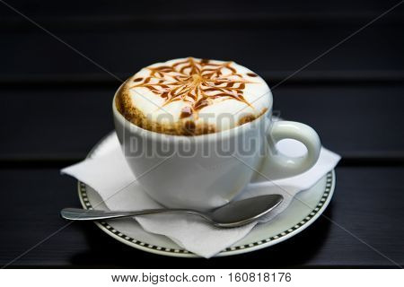 cup of cappuccino cup of coffee cup of coffee on brown wooden table
