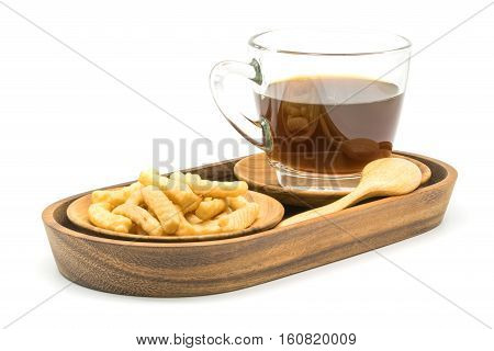Prawn cracker and a cup of black coffee in a wooden tray on white background