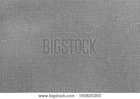 the textured background or wallpaper from rough fabric of gray color and a blank space