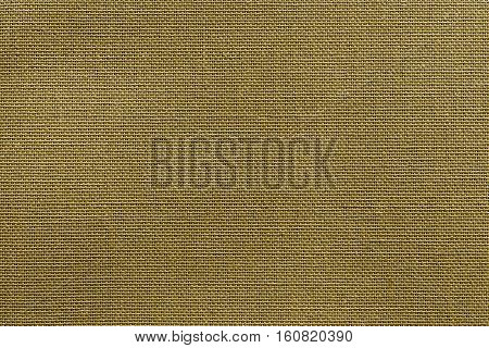 the textured background or wallpaper from rough fabric of khaki color and a blank space
