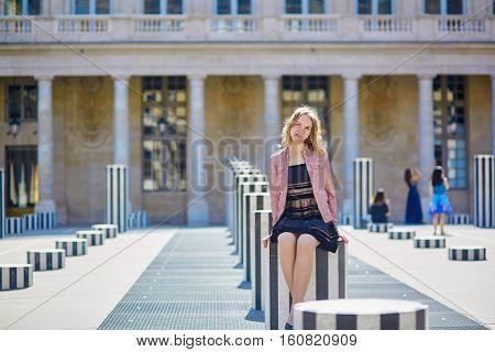 Beautiful Young Woman Walking In Paris