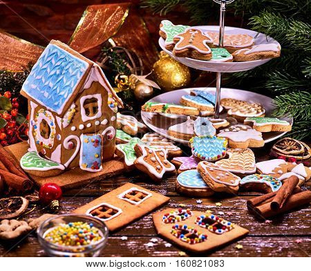Gingerbread house . Christmas still life with Christmas cookies on Tiered Cookie Stand.