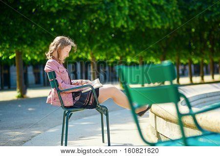 Beautiful Young Parisian Woman Reading A Book