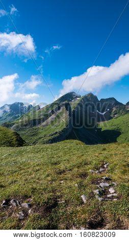 A landscape showing mountains beneath a blue sky