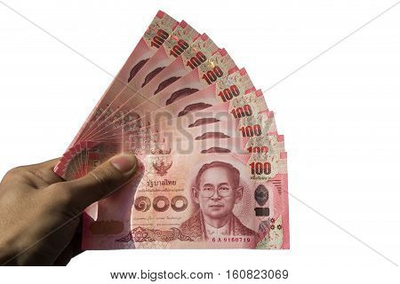 Asian men left hand hold few hundred banknotes of Thailand isolate on white background (Thai baht). This has clipping path.