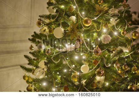 Elegant Christmas tree decorated with glistening glass balls a beads and fairy lights.