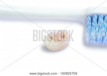 Tooth decay dental caries and tooth brush on white background