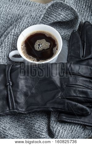 View Close-up On Black Women's Gloves And Coffee Cup