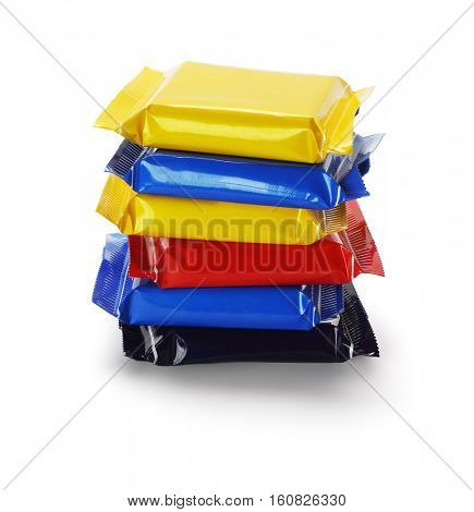 Stack of Chocolate Bars In Colorful Plastic Wrappers on White Background