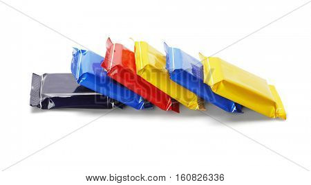 Chocolate Bars In Colorful Plastic Wrappers on White Background