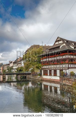 View of embankment of the Ill river in Petite France district with Maison des Tanneurs (tanners house) Strasbourg France