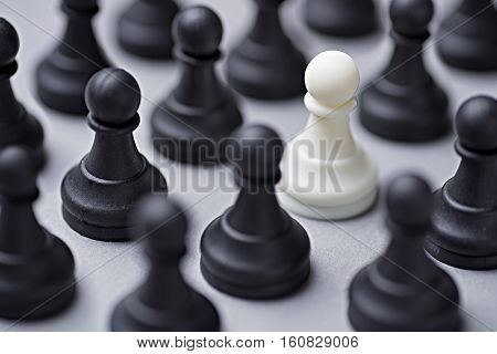 Single White Chess Pawn Amongst Black Ones