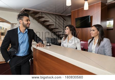 Young Business Man On Hotel Reception Office, Businessman Check In Formal Trip Arrive Woman At Front Desk Meeting Stuff