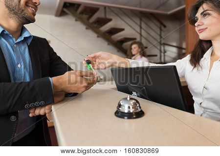 Business Man Arriving To Hotel Woman Receptionist Give Key Room Registration At Reception Counter Checking In