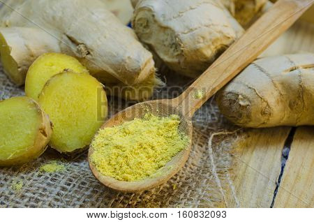 fresh ginger, dry ginger closeup on wooden background