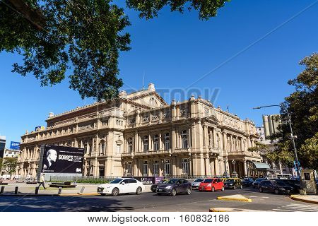 Buonos Aires Argentina - October 29 2016: Facade of the Teatro Colon in Buenos Aires and traffic in the street