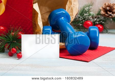 Christmas Gift Blue Sport Dumbbells With Copyspace Business Card