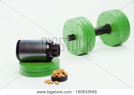 dumbbells and nutritional supplements for bodybuilding. High Resolution. sports nutrition. barbell.