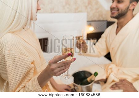 Young Couple In Hotel Bed Drink Champange, Happy Smile Hispanic Man And Woman Lovers In Bedroom