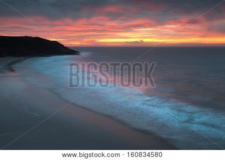 Daybreak at Caswell Bay Sunrise at Caswell Bay, one of the most popular and easily accessible beaches on the Gower peninsula in Swansea