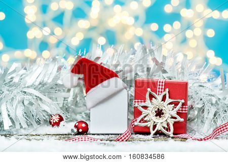Wooden board with Christmas cap on Christmas gift Christmas decoration