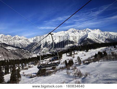 Chair-lift at ski resort and snow winter mountains at nice sun day. Caucasus Mountains. Hatsvali Svaneti region of Georgia.
