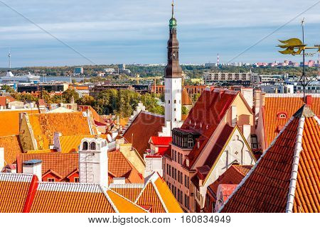 Cityscape view on the buildings with red roofs in the old town of Tallin, Estonia