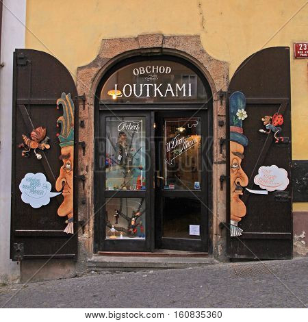 PRAGUE, CZECH REPUBLIC - SEPTEMBER 30, 2015: Small puppets shop with on the street in the Old Town of Prague, Czech Republic. Square image