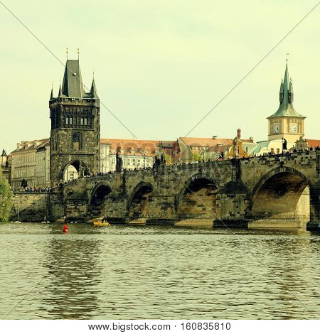 Beautiful view with Famous Charles Bridge tower and Vltava river, Prague, Czech Republic. Square toned image