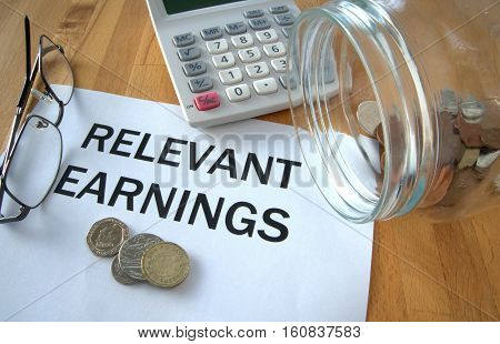 Relevant Earnings with coins on paper and in pot and calculator behind