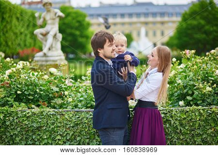 Happy Family Of Three In Paris On A Summer Day