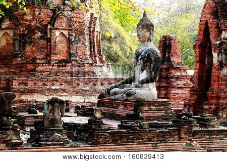 Ancient buddha statue at Mahathat temple historic site in Ayuttaya provinceThailand.