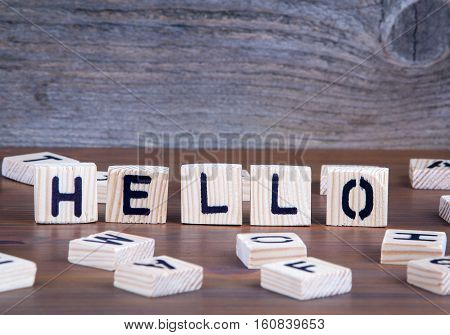 Hello from wooden letters on wooden background