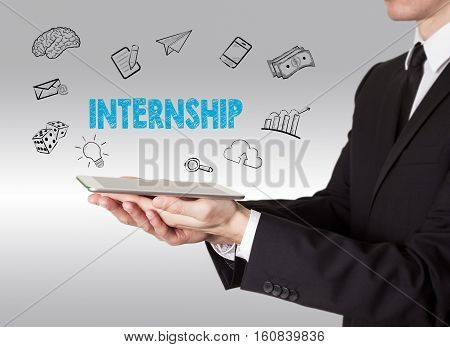 Internship concept, young man holding a tablet computer
