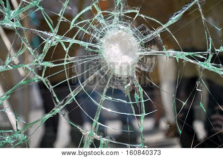 Texture of broken cracked glass. Glass test impact resistance.