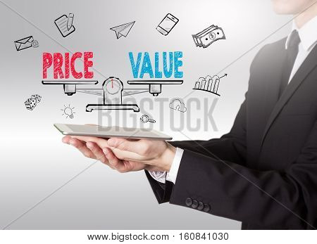 Price and Value Balance, young man holding a tablet computer