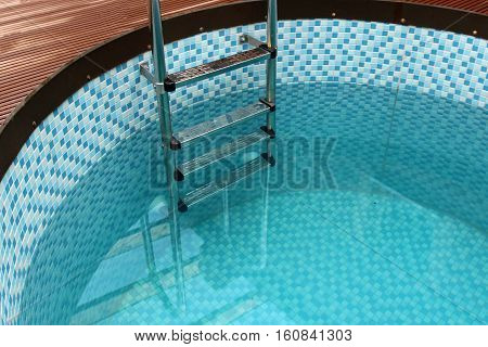 A small pool for cooling off after the sauna