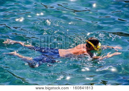 Enjoying Snorkelling With Clear Cold Blue Water